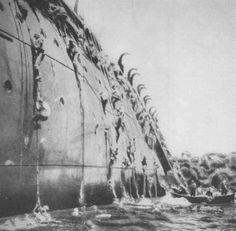 Troop transport USS President Coolidge sinks near the beaches of Guadalcanal, while trying to save his crew