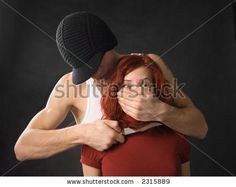 Gangster with a knife threatening young woman by Zdorov Kirill Vladimirovich, via ShutterStock