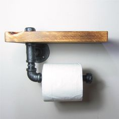 Add a little Industrial/Urban chic to your bathroom Combining a handy wooden shelf and using iron pipes to make the sturdy roll holder. Made from natural grained wood so each piece is unique. - Size: