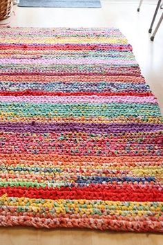 This beautiful crochet rug didn't cost a penny but it looks like a million bucks! Create a one-of-a-kind rug from old sheets and t-shirts like this one on Damsel & Baron. What a awesome w…