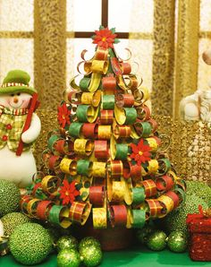 Cut here, paste there and you create a stunning Christmas tree using strips of scrapbook paper decorated.
