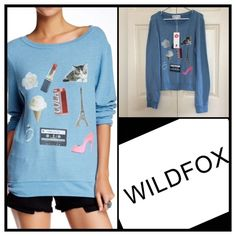 """✨WildFox """"My Favorite Things"""" Baggy Beach Jumper✨ Beautiful Blue Brand New Wildfox Baggy Beach Jumper. The Softest and Coziest ever! NWTs. Size Medium. NO TRADES. All Offers considered and welcomed.  Wildfox Tops Sweatshirts & Hoodies"""