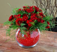 Flower arrangement for Valentine's day...carnations and cinnamon hearts...looks so pretty