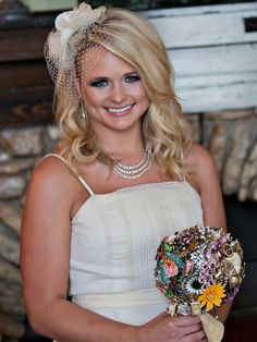 Beautiful bride Miranda Lambert with her vintage brooch bouquet by The Ritzy Rose.