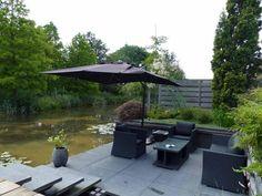 Tuin verlengen met terras aan het water