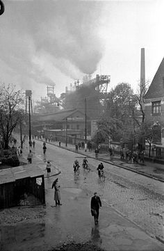 Erich Lessing  West-Germany. Town of Duisburg. Workers leaving the steelworks. 1951