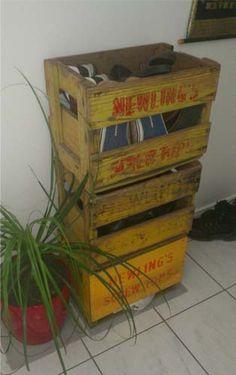 Antique soft drink crates for shoe storage
