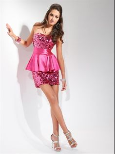 P5651 - Dazzle.  This micro-mini is covered in sequins for guaranteed glitz.  Corset back closure for ultimate fit and satin peplum for ultimate trend.
