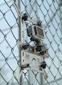LynkSpyder mounted to a chain link fence at a baseball field with a GoPro Hero 3.