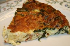 A cheesy Crustless Spinach and Bacon Quiche that's lower in carbs than a traditional quiche and tastes fantastic. You won't miss the crust!