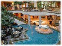 Club olympus spa fitness swimming pool at night more information on berlin for Grand hyatt beijing swimming pool