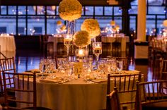 Flower Balls on Glass Vases Reception Decor Ideas | photography by http://www.farnazk.com/bridal