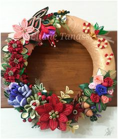 Golden Christmas Door Wreath with Quilled Winter Flowers (Poinsettia, honeywort, eranthis, fuschia, roses, acorn, holly. . . ) in Red, Purple and Peach ~ August 2016, handmade by Eliane Tanassi ♧ The Quilling Fairies ♧ Facebook