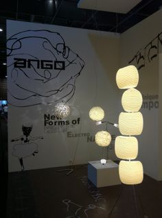 Picture from the exhibition at the Maison et Objet show in Paris. In front: 5 stone floor lamp (polymer foam tubes with inlayed rattan stripes) In back: Chrysalis sky floor lamp (stainless steel base with round lamp shade made of silk cocoons. www.udogangl.com Round Lamp Shade, Paris Shows, Stone Flooring, Rattan, Floor Lamp, Table Lamp, Chandelier, Stripes, Base
