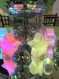 These mirror ball centerpieces were created for a disco-themed Bat Mitzvah. We used rotating-color stars and LED lights so that the colors of the centerpieces were constantly changing. Under the dimmed evening light, they looked very cool indeed!More Social Events...<<Back to…