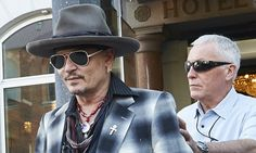 Johnny Depp's bodyguard has said the Hollywood actor's estranged wife Amber Heard is 'making up' accusations of domestic abuse in order to boost her divorce settlement, it is claimed.