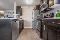 Velocity in Harbour Landing is a new condo community located in Regina's beautiful Harbour Landing New Condo, Maui, Kitchen Cabinets, How To Plan, Table, Furniture, Home Decor, Restaining Kitchen Cabinets, Homemade Home Decor