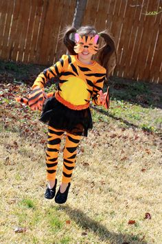 Couple costume mike tyson tiger body paint adorable tiger has the tutu hatmight be just what the halloween funhalloween costume ideasgirls tiger costumediy solutioingenieria Images