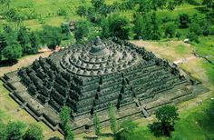 Borobudur Temple, Magelang(Java) बोरोबुदूर मंदिर, मागेलँग(जावा) Dated: 8th century With a Temple plan of a Tantric Yantra, approximately 55,000 cubic metres (weighing 1,44000tons ) of andesite stones were taken from neighbouring stone quarries to build the monument.