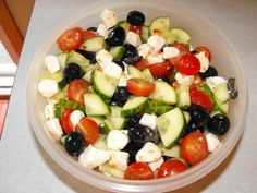 Easy- cucumber, tomatoes, olives, red onion & mozzarella in italian dressing! I would omit the olives and try feta in place of the mozzarella.