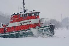 Tug Boat chopping through ice - Sandusky Bay
