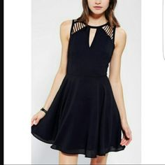 Urban Outfitters LBD Feminine black dress. Worn only once as a brides maids dress. Open latticework on the upper chest and back . Zip closure . Brand: sparkle and fade from UO Urban Outfitters Dresses