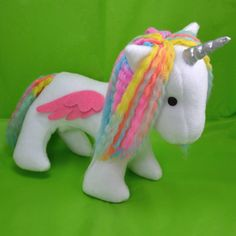 Buttercup the unicorn plush toy soft and cuddly by Plusheez