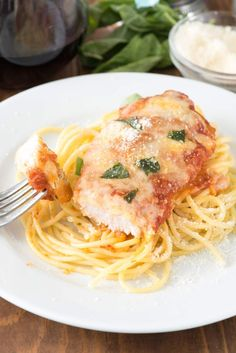 Easy Chicken Parmesan - this quick dinner recipe is totally foolproof. The chicken comes out moist every time! It's the BEST chicken parmesan recipe we've ever had.
