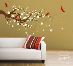 Why did I never consider this before? It mixes a tree, birds, and flowers all in one INSIDE the house. LOVE IT! (Cherry Blossom branch decal wall sticker @ $67.)