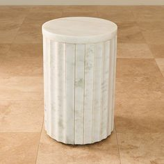 Cool, creamy white marble panels encircle an iron base giving rich, wonderful detail to our Marble Column Table. The smooth carved marble creates a calm yet luxe look and the neutral tones make it a piece that will compliment an array of home décor styles.