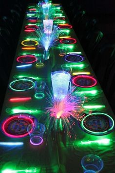 New Years Eve Glow In The Dark Dinner Party- Just Add Glow Sticks Around The Plates and Cups