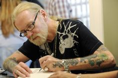 """Gregg Allman signs copies of his book """"My Cross to Bear"""" at The Allman Brothers Band Museum at The Big House in Macon, Ga."""