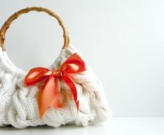 Totally adore her bags!  http://www.etsy.com/listing/69983950/knitted-spring-hand-bag-handbag-everyday