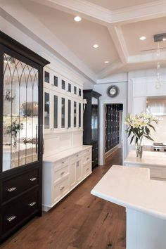 Black and white cabinets together.
