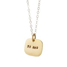 """Speak from your heart with this gold-plated charm embossed with Ti amo—""""I love you"""" in Italian."""
