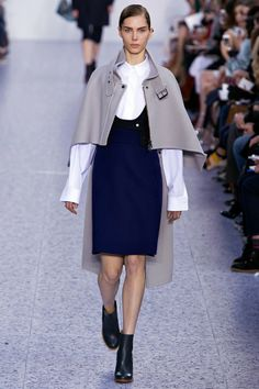 2b. Chloe Fall 2013 Inspired by the inverness cape worn by men. Outer cape that clasp in the front at the throat