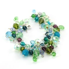 Round Swarovski crystals in shades of light grean, carribbean blue, turquoise and aquamarine. Bunch of crystals :) Diuu