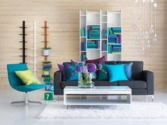 Turquoise pillows on gray couch.