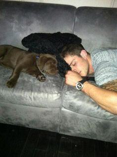 Tyler Seguin and the most adorable chocolate lab puppy <3