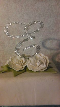 Absolutely beautiful custom cake toppers by Polka Dots & Pixies.  Swavorski crystals enhance these beautiful toppers. And there is a lot more to look at on her page.