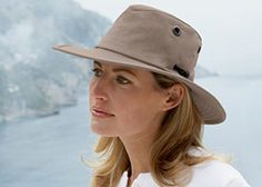Tilley hats  -  nice looking hat and it has some shape/curves to it.  it's not just flat and round or really dark colored.     lj