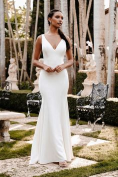 9853 by Allure Bridals represents a classic bride with a subtle V-neckline and a lux plain crepe fabric Classy Wedding Dress, Simple Wedding Gowns, Stunning Wedding Dresses, Affordable Wedding Dresses, Wedding Dress Sizes, Dress Wedding, Wedding Reception, Elegant Bride, Bridal Gowns