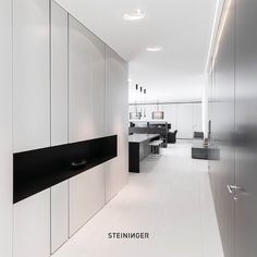Subtle hues of white for walls and flooring  create a soothing ambiance only contrasted by kitchen PURE in concrete & dark oak. Interiors by STEININGER are purist, functional and simply luxurious. Customers experience a harmonious overall concept, coming from a single source - from the planning of single rooms to individual colour schemes and lighting concepts, as well as  the manufactoring of  customized kitchens, bespoke furniture and complementary accessories.  KITCHEN - INTERIOR DESIGN… Lighting Concepts, Bespoke Furniture, Colour Schemes, Interior Design Kitchen, Interior Architecture, Concrete, Kitchens, Walls, Rooms