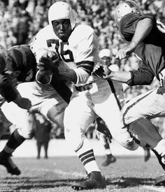 Marion Motley /  He was a leading pass-blocker and rusher for the Cleveland Browns in the late 1940s and early 1950s, and ended his career with an average of 5.7 yards per carry, a record for a fullback that still stands.  Watch some tape of this guy and you will be in awe.  Hall of Fame 1968.