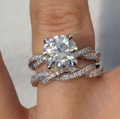 Represent your everlasting love with a stunning Michael B. Jewelry infinity braid engagement ring and wedding band! Available at TWO by LONDON Americana Manhasset