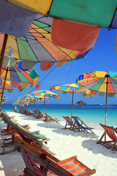 Colorful beach umbrellas under blue sky, Phuket Beach - Thailand