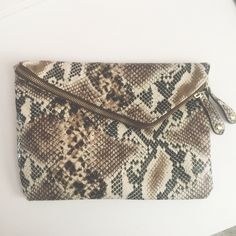 ALDO Snakeskin Foldover Clutch No flaws. Large clutch with zipper compartment and inside flap. ALDO Bags Clutches & Wristlets