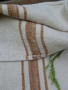 This shop has the most fabulous antique grain sacks and fabric  antique grain sack elegant FADED TOFFEE 47.24 long upholstery and cushion fabric