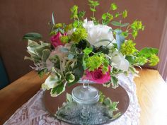Cake stand arrangement by Apple Blossom Flowers & Wedding Hire