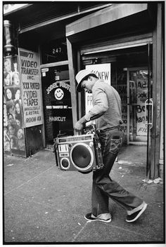 Boy carrying a boom box